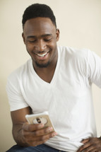 African American man texting