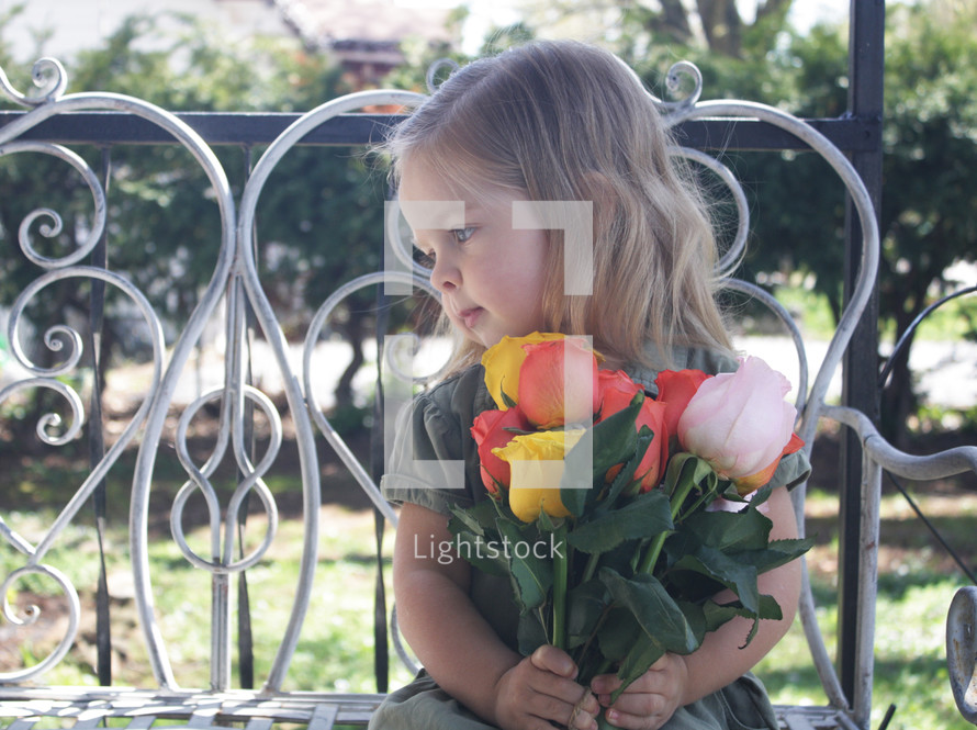 a child holding a bouquet of tulips