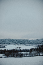 distant farm house in snow