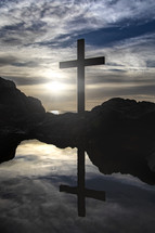 reflection of cross and tide pool
