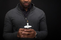 a man holding a candle