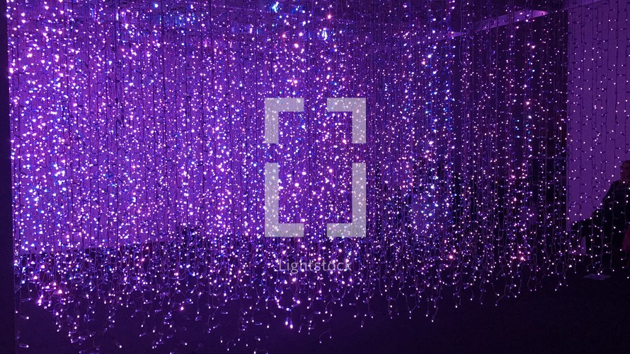 sparking curtain of lights and purple stage