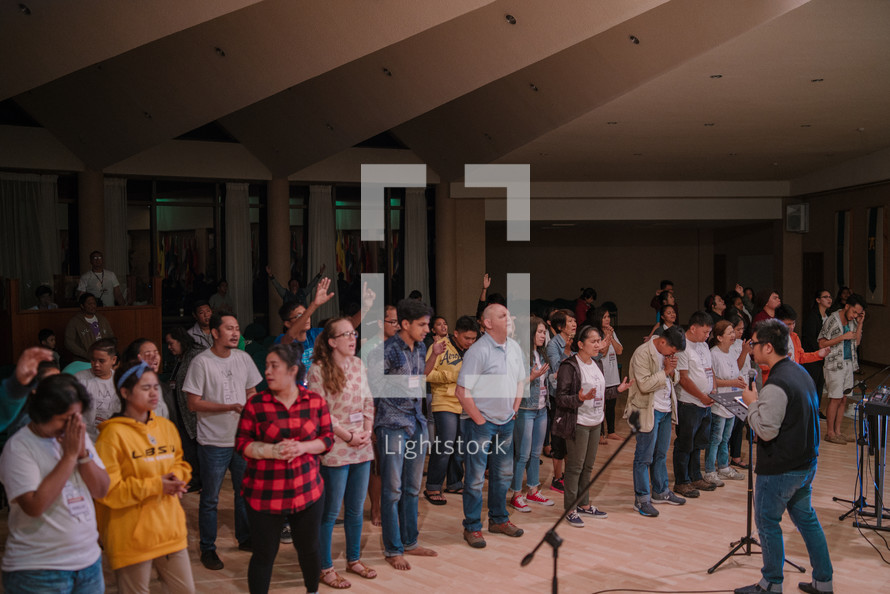 standing in song at a worship service