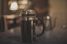 A french press brewing coffee