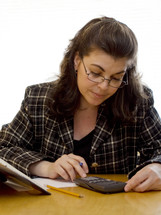 woman working on a calculator