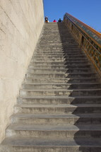 Long and steep flight of stone steps.