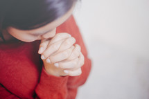a woman in prayer