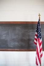 American flag and blackboard