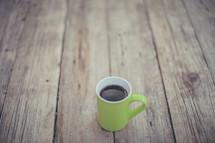 coffee mug on a wood table