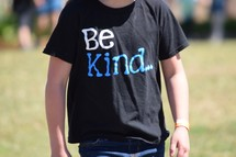 child wearing a Be kind t-shirt