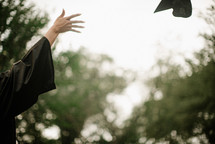 a girl tossing her cap at graduation