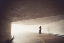 Couple hugging in a tunnel