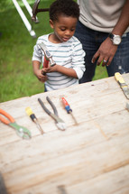 father and son using tools
