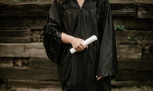a female graduate holding a diploma