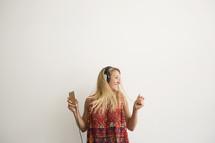 teen girl dancing to music