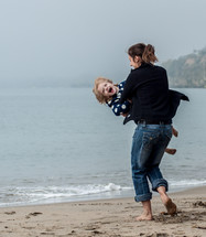 mother and child playing on a beach