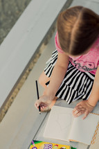Young elementary age girl, drawing a house, church, color, art, activities, school, child