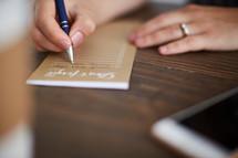 a woman making a list