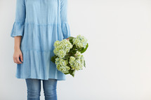 a woman holding a bouquet of flowers