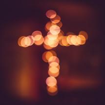 bokeh lights in the shape of a cross