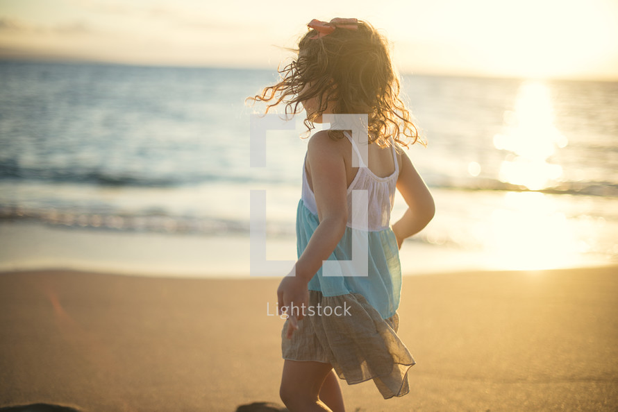 girl child running on a beach