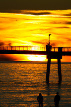 bridge over the ocean and sunset