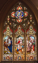 A stained glass church window depicting Jesus and Mary.