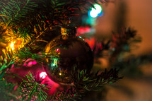 ornaments and lights on a Christmas tree