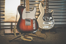electric guitars on stands
