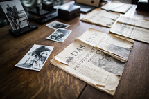 photographs and a German newspaper clipping