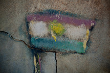 smeared Iraqi flag pained on stone
