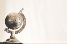 metal globe paper weight