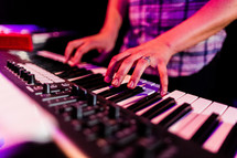 man playing a keyboard