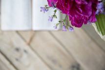 flowers in a vase on a wood table