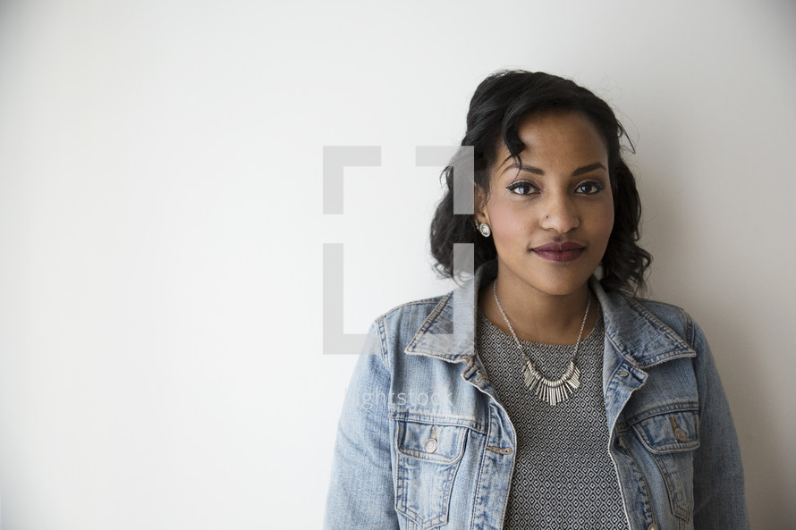 portrait of an African American woman in a jean jacket