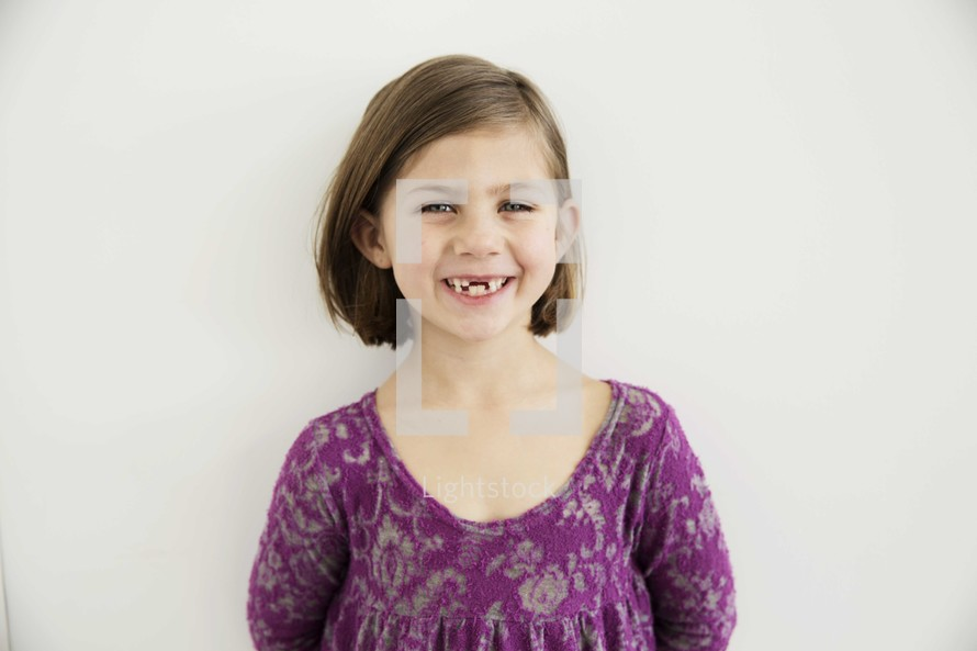 portrait of a toothless young girl