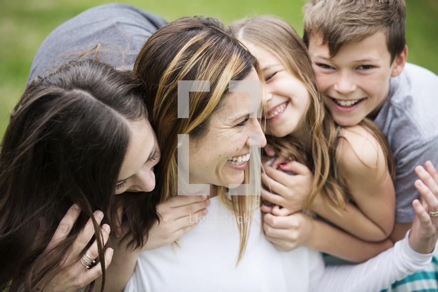 children hugging mom