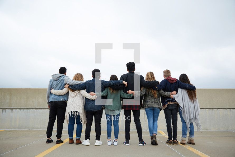 group of teens with arms around each other
