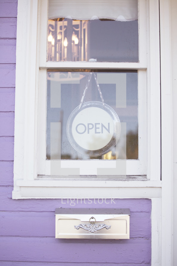 open sign in a window