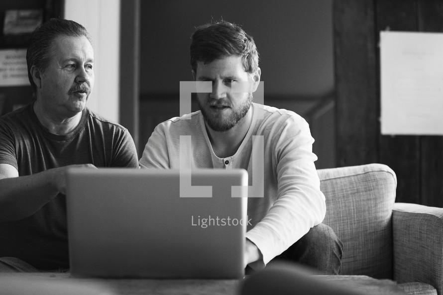 men looking at a computer screen