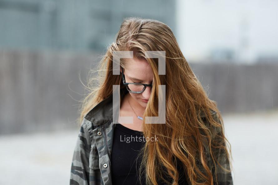 teen girl looking down