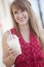 Woman holding a frozen latte.