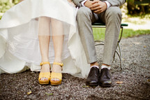feet of a bride and groom