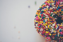 sprinkled donut on a white background