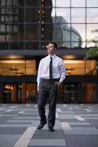 A man in a business suit in a courtyard