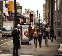 people walking on the sidewalk on west 36th street