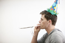 A man wearing a party hat.