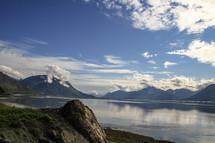 mountains around a lake