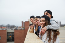 group of teens looking over a parking deck