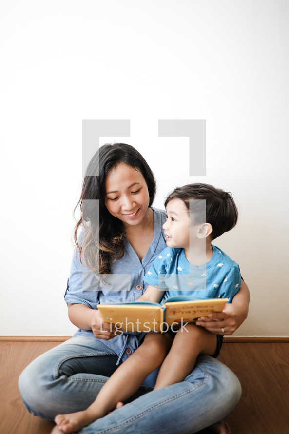 a mother reading to her child
